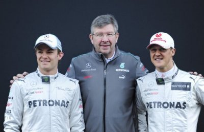 Michael Schumacher of Germany, right, Nico Rosberg of Germany, left, and Mercedes GP F1 team Principal Ross Brawn, pose during new F1 W03 official presentation of Mercedes GP Formula one team 2012 at the Montmelo racetrack near Barcelona, Spain, Tuesday,
