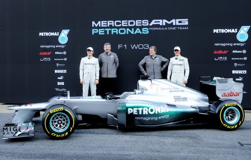 ichael Schumacher of Germany, left, Nico Rosberg of Germany, right, Mercedes GP F1 team Principal Ross Brawn, second left, and Mercedes Motorsport boss Norbert Haugun, second right, take part during new F1 W03 official presentation of Mercedes GP Formula