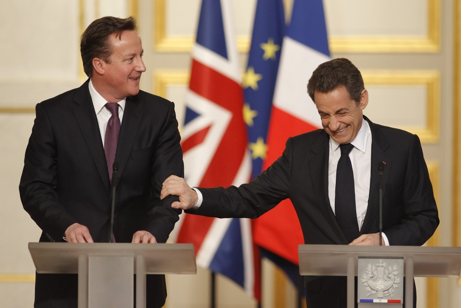 France's President Sarkozy and Britain's Prime Minister Cameron attend a news conference during a Franco-British summit at the Elysee Palace in Paris