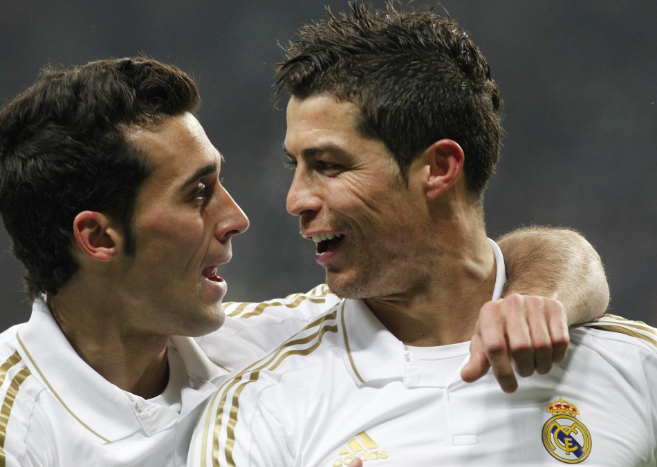 Real Madrid's Ronaldo celebrates after scoring against CSKA Moscow with team mate Arbeloa during their Champions League last 16 first leg soccer match at the Luzhniki stadium in Moscow
