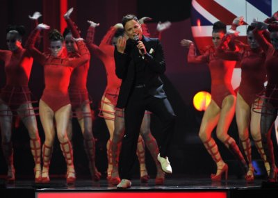 Olly Murs performs during the BRIT Music Awards at the O2 Arena in London