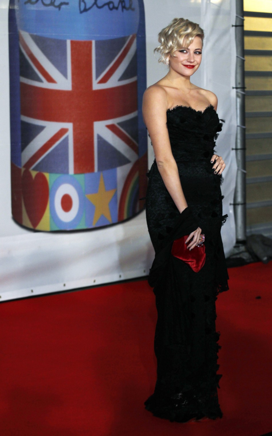 British singer Pixie Lott arrives for the BRIT music awards at the O2 Arena in London