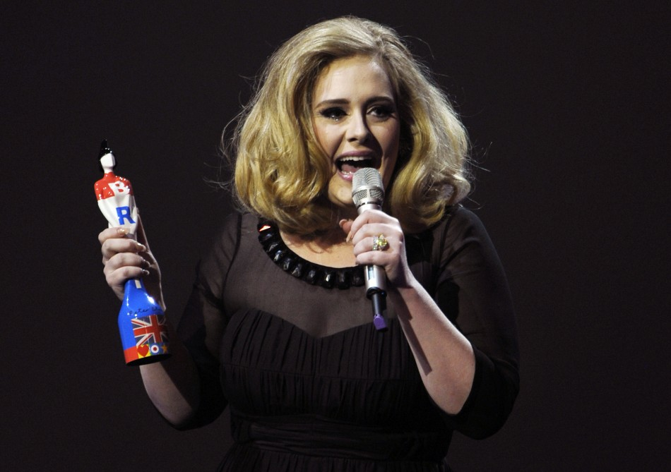 Adele speaks as she holds her award for best British female solo artist during the BRIT Music Awards at the O2 Arena in London