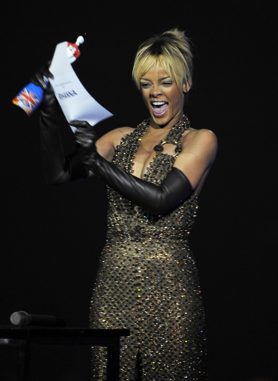 Rihanna reacts after being awarded best international female artist during the BRIT Music Awards at the O2 Arena in London