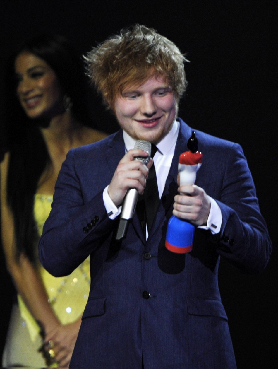 Ed Sheeran holds his best British breakthrough award during the BRIT Music Awards at the O2 Arena in London