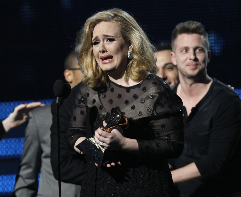 Adele accepts Album of the Year award at the 54th annual Grammy Awards