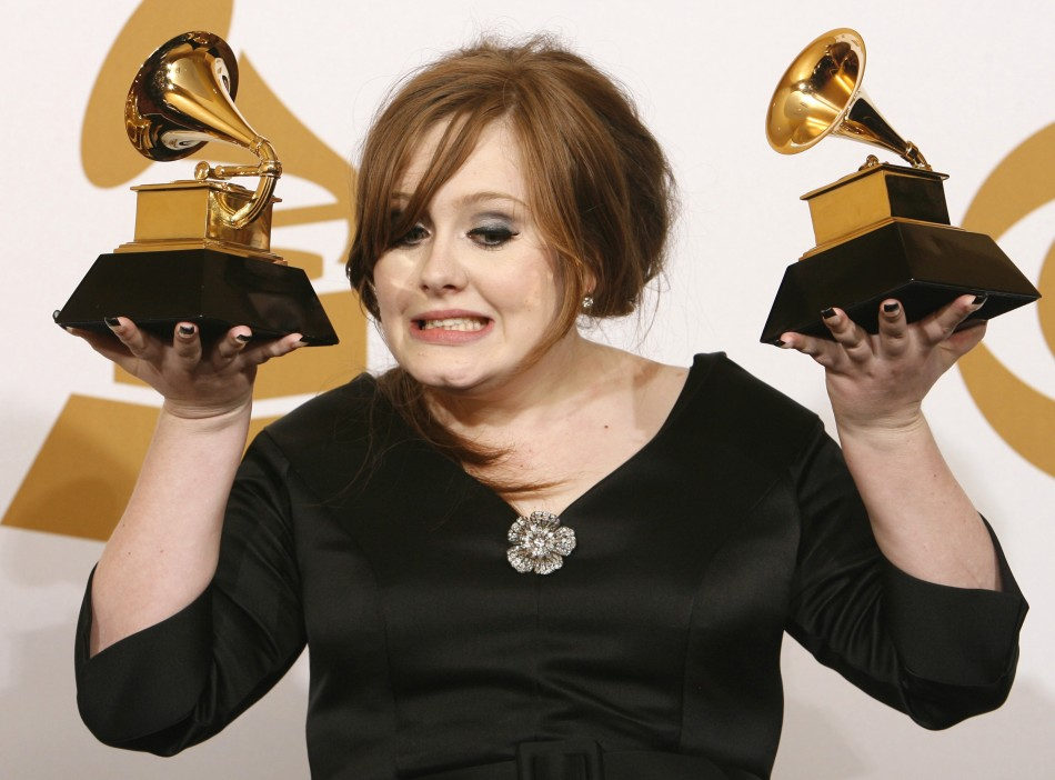 Adele holds her awards for Best New Artist and Best Pop Vocal Album