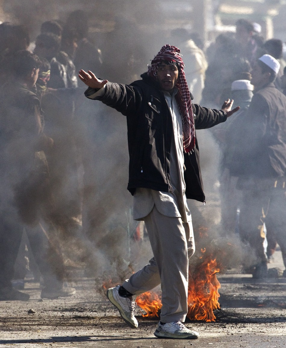 An Afghan protester gestures during a protest near a U.S. military base in Kabul