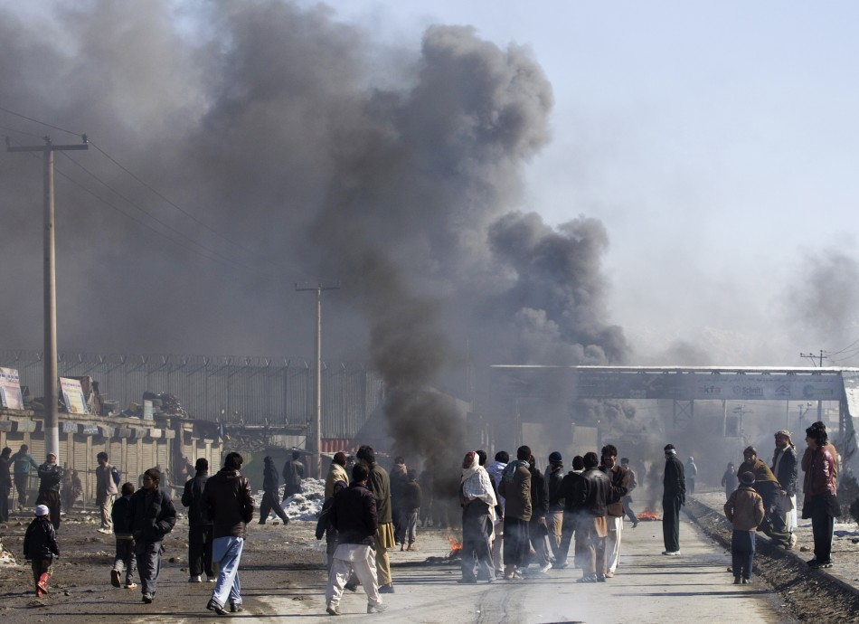 Smoke rises from part of a base belonging to foreigner during a protest in Kabul