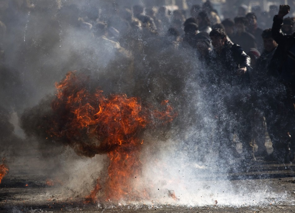 Fuel burns as Afghans protest near a U.S. military base in Kabul
