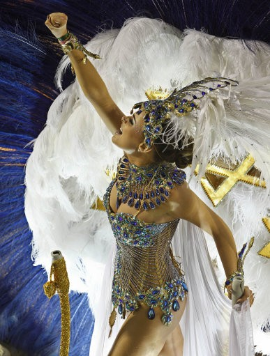 A dancers of Grande Rio samba school parades on a float during carnival celebrations at the Sambadrome in Rio de Janeiro, Brazil, Tuesday, Feb. 21, 2012.