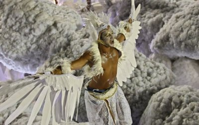 A dancer of Grande Rio samba school parades on a float during carnival celebrations at the Sambadrome in Rio de Janeiro, Brazil, Tuesday, Feb. 21, 2012. Nearly 100,000 paying spectators turn out for the all-night spectacle at the Sambadrome