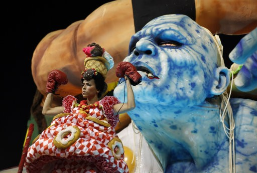 A performer from the Grande Rio samba school parades during carnival celebrations at the Sambadrome in Rio de Janeiro, Brazil, Tuesday, Feb.21, 2012. Nearly 100,000 paying spectators turn out for the all-night spectacle at the Sambadrome