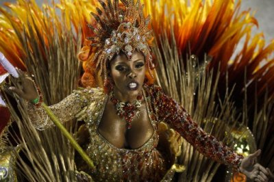 A dancer of Grande Rio samba school parades during carnival celebrations at the Sambadrome in Rio de Janeiro, Brazil, Tuesday, Feb. 21, 2012. Nearly 100,000 paying spectators turn out for the all-night spectacle at the Sambadrome