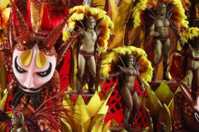 Dancers of Salgueiro samba school parade on a float during carnival celebrations at the Sambadrome in Rio de Janeiro, Brazil, Tuesday Feb. 21, 2012.