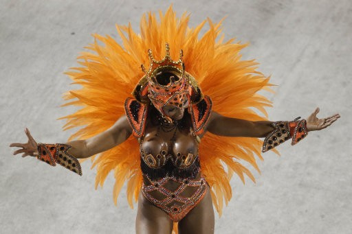 EDS NOTE NUDITY - A dancer from Salgueiro samba school parades during carnival celebrations at the Sambadrome in Rio de Janeiro, Brazil, Tuesday Feb. 21, 2012.