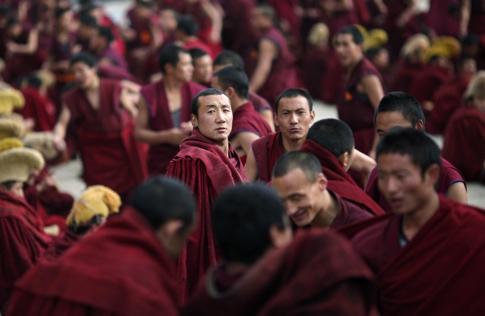 Monks gather outside a temple during Tibetan New Year celebrations in Langmusixiang
