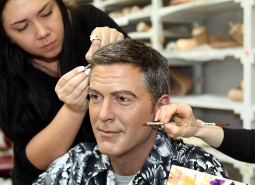 The Madame Tussauds039 George Clooney wax figure being 039spruced up039 ahead of the Oscars, Madame Tussauds, London.