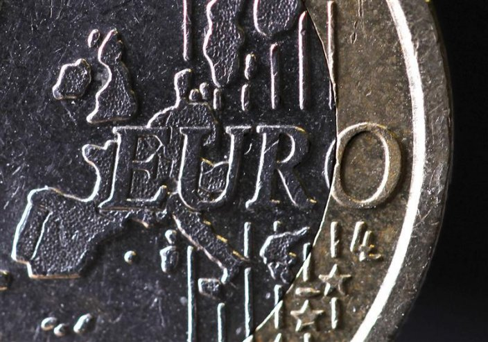 The map of Europe is featured on the face of a one Euro coin seen in this photo illustration taken in Paris