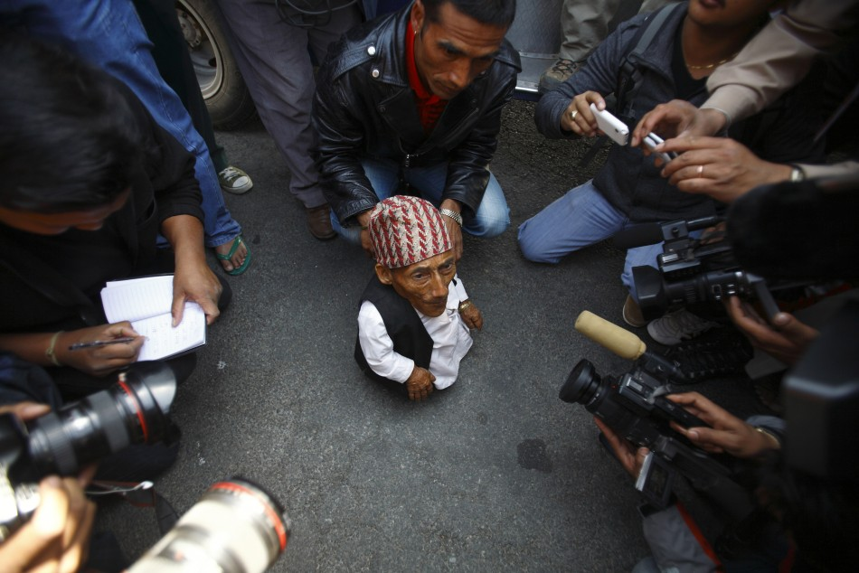 Dangi, 72, who claims to be the world039s shortest man standing at a height of 22 inches, speaks to the media at Tribhuvan International Airport upon his arrival in Kathmandu