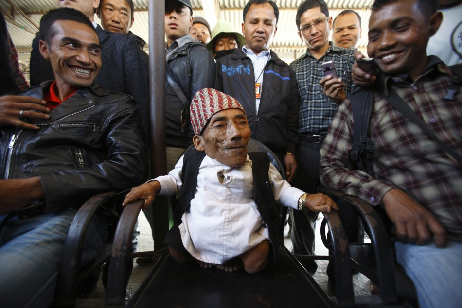 Dangi, 72, who claims to be the world039s shortest man standing at a height of 22 inches, speaks to the media at Tribhuvan International Airport upon his arrival, in Kathmandu