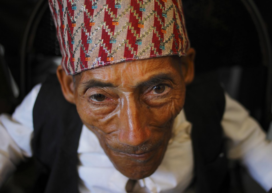 Dangi, 72, who claims to be the world039s shortest man standing at a height of 22 inches, is pictured at Tribhuvan International Airport upon his arrival in Kathmandu