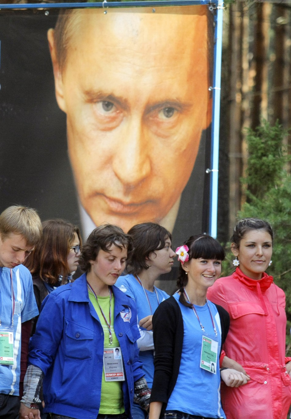 "Participants pass a poster of Russian Prime Minister Vladimir Putin during his visit to the summer camp of the pro-Kremlin youth group ""Nashi"""