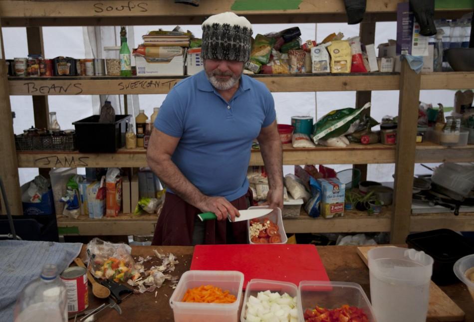 Camp cook prepares dinner