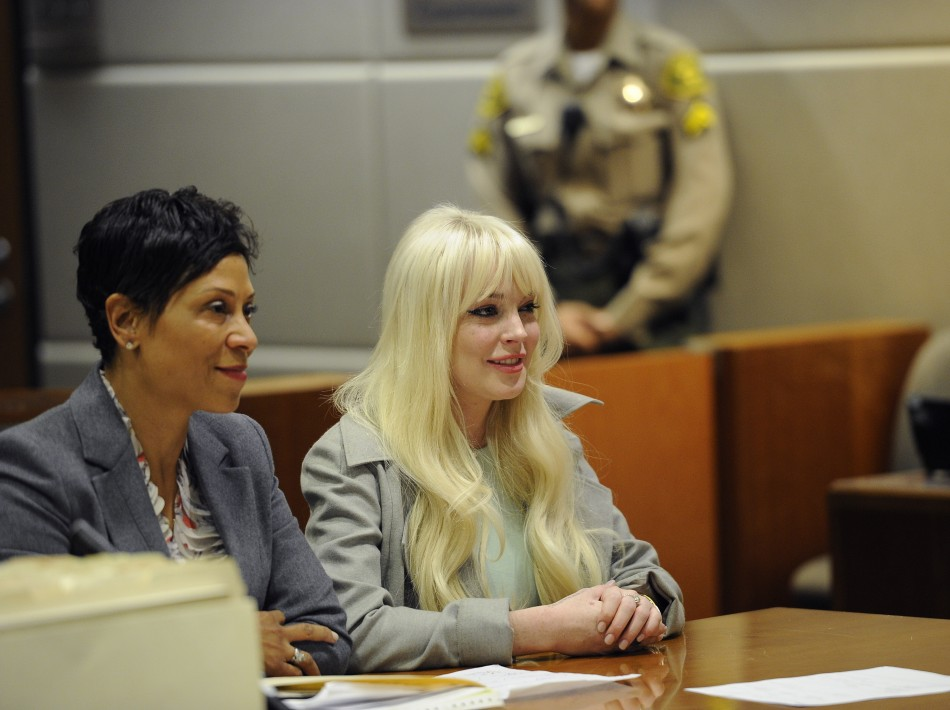Actress Lindsay Lohan and her attorney Shawn Chapman Holley attend a progress report hearing on her probation at the Airport Branch Courthouse in Los Angeles