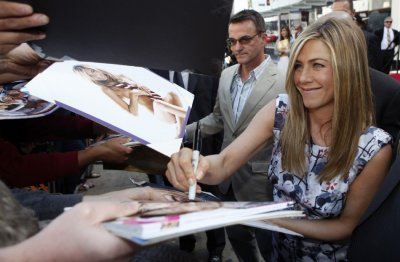 Actress Jennifer Aniston signs autographs