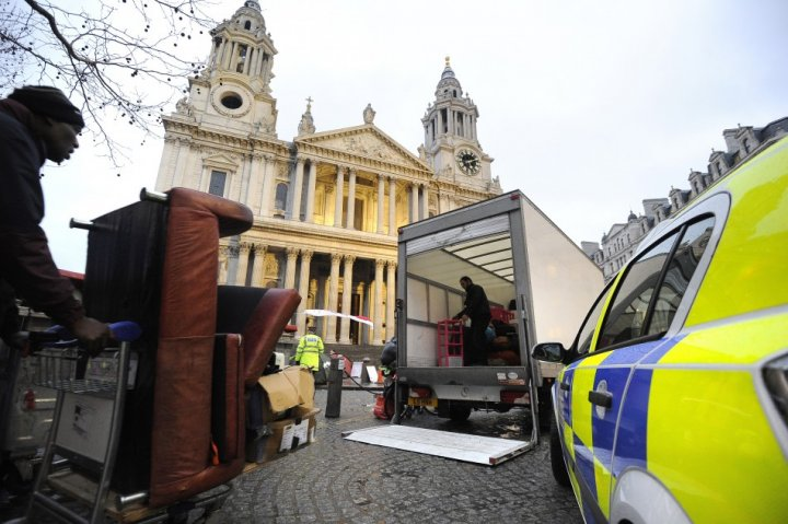 Occupy supporters begin to dismantle encampment from outside St Paul's Cathedral after losing appeal against eviction