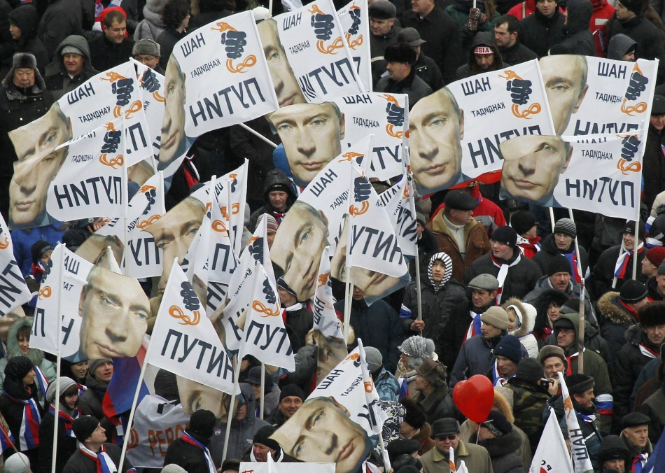 People rally in support of Russian Prime Minister Vladimir Putin's bid for re-election at Luzhniki stadium on Defender of Fatherland Day in Moscow