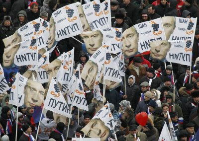 People rally in support of Russian Prime Minister Vladimir Putins bid for re-election at Luzhniki stadium on Defender of Fatherland Day in Moscow