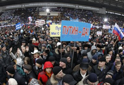 People take part in rally for Putin