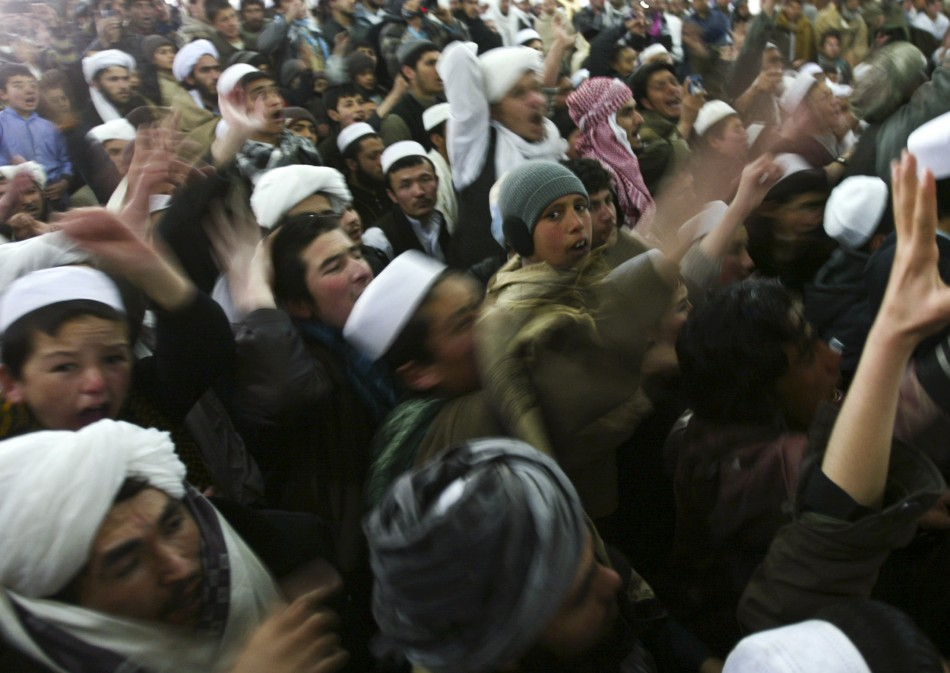 Afghan protesters shout anti-U.S. slogans during a protest against the burning of Korans by US troops