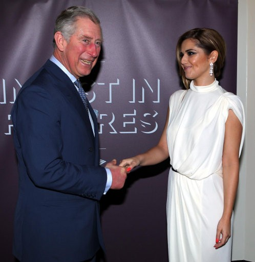 The Prince of Wales meets Cheryl Cole right at the Prince039s Trust039s Invest in Futures gala dinner held at The Savoy, London.