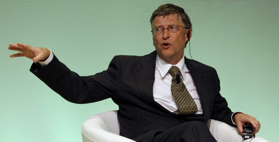 Bill Gates gestures as he speaks during an IFAD Annual Governing Council in Rome