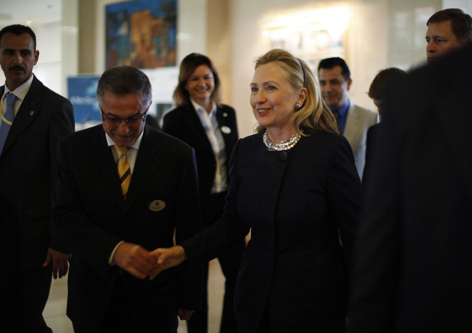 U.S. Secretary of State Hillary Clinton arrives at her hotel in Tunis