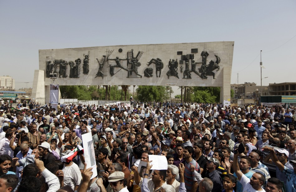 Residents gather at Tahrir Square during a demonstration in central Baghdad