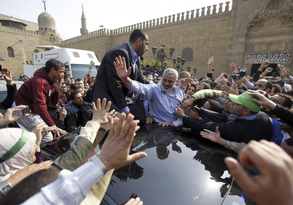 Hamas leader Ismail Haniyeh waves to his supporters following his speech after Friday prayers at Al-Azhar mosque in Cairo
