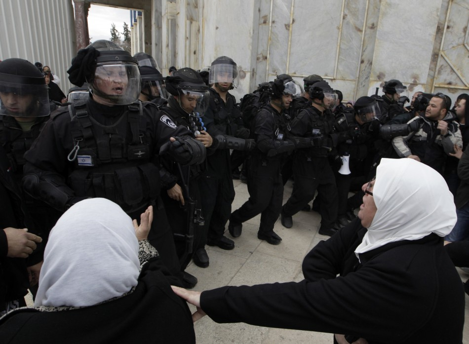Palestinian women shout at Israeli policemen