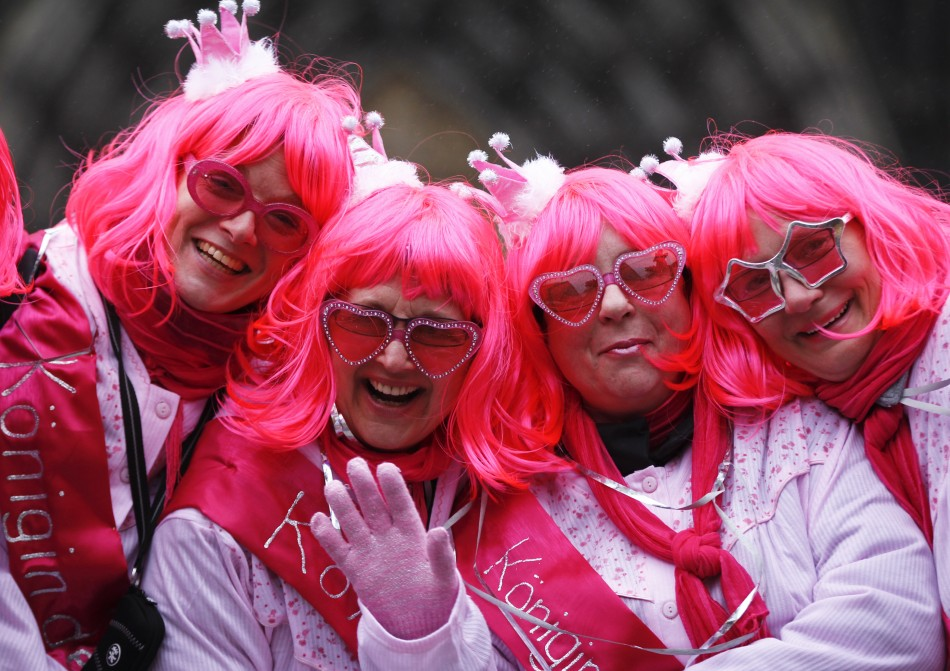 "Women dressed for ""Weiberfastnacht"" (Women's Carnival) celebrate in front of Cologne's cathedral"