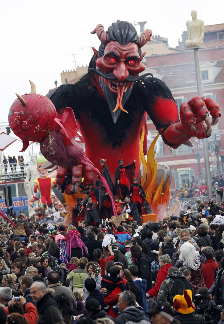 A float with a giant figure representing a devil is paraded during the Nice Carnival