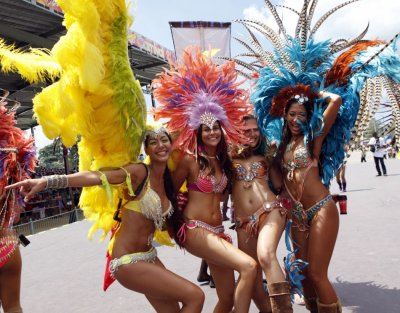 Masqueraders dance on stage on the final day of the carnival at Queens Park