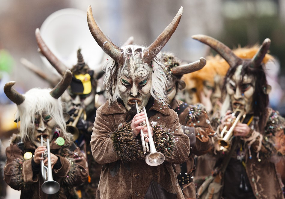Musicians dressed for carnival perform at the Luzern-Carnival