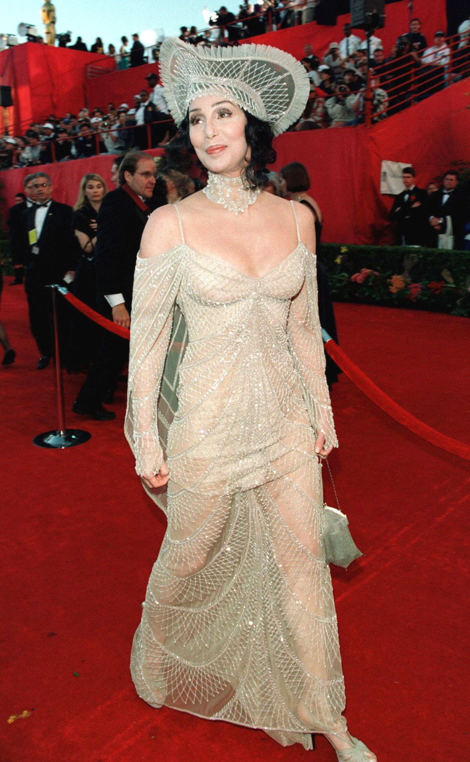Wearing a Bob Macki gown, former Academy Award winner for best actress Cher arrives at the 70th annual Academy Awards at the Shrine Auditorium in Los Angeles March 23.