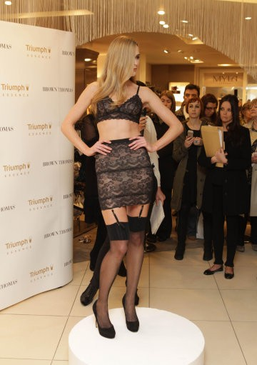 A model wears lingerie designed by supermodel turned designer Helena Christensen at the launch of the Triumph Essence SpringSummer 2012 Collection at Brown Thomas department store in Dublin.