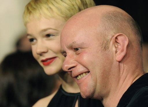 British writer Nick Hornby, right, an Academy Award nominee for Best Adapted Screenplay for quotAn Education,quot poses with cast member Carey Mulligan, an Academy Award nominee for Best Actress