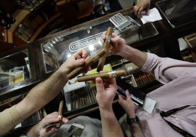 People buy cigars at a store