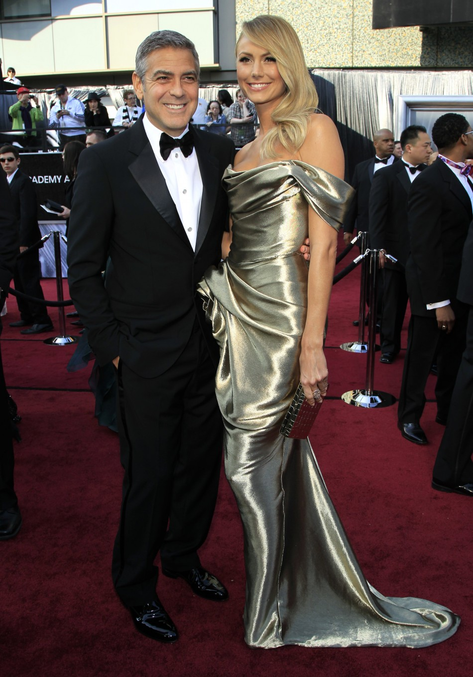 Actor George Clooney and girlfriend Stacy Keibler pose on the red carpet as they arrive at the 84th Academy Awards in Hollywood